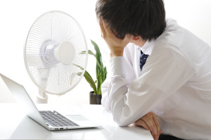business man with computer and fan
